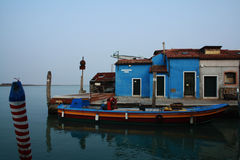 Blue boat. Colorful house and boat in Burano Stock Images