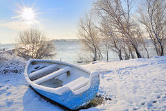 Blue boat on danube river. In the morning against sun Stock Photos