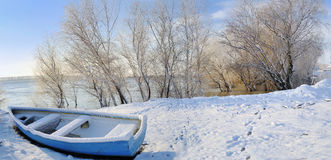 Blue boat on danube river Stock Photo