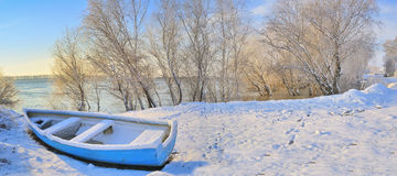 Blue boat on danube river. In winter time Stock Images