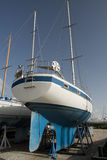 Blue boat on dock for maintaines Royalty Free Stock Photos