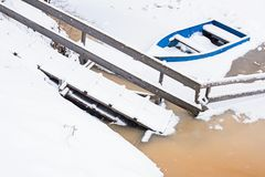 Blue boat on freezing pier in winter Stock Photography