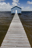 Blue boat house on river Stock Photos