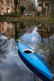 Boat kayak with reflection on water. Merchtem, Belgium. Blue boat kayak with reflection on water. Merchtem, Belgium Stock Photos