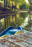 Blue boat on lake in autumn season Royalty Free Stock Photography