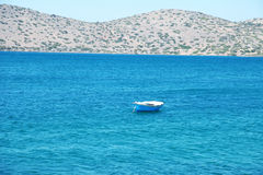 Blue boat at a Mediterranean sea (Greece) Royalty Free Stock Image
