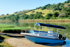 Blue boat on morning river. Shot in Port Edward, Kwazulu-Natal, South Africa Stock Photography