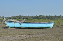 Blue boat near seashore Royalty Free Stock Photo