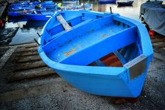 Blue boat near the water. Blue boat near the sea with a few more boats on the water in Bari Royalty Free Stock Images