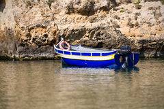 Blue boat with outboard engine at Gozo Malta Stock Image