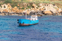 Blue boat at port of city Mgarr Malta Stock Photos