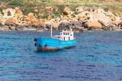 Blue boat at port of city Mgarr Malta Stock Photos