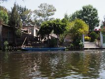 Blue boat on river at Xochimilco`s Floating Gardens in Mexico stock image