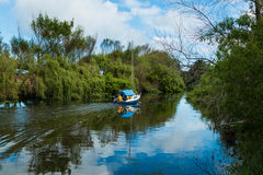 Blue Boat River Stock Photography