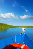 Blue boat sailing in Albufera lake of Valencia Stock Images