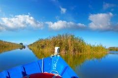Blue boat sailing in Albufera lake of Valencia Stock Photos