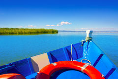 Blue boat sailing in Albufera lake of Valencia Stock Image