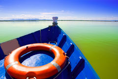 Blue boat sailing in Albufera lake of Valencia Royalty Free Stock Photos