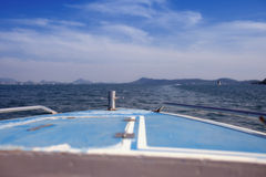 Blue boat sailing in the sea Royalty Free Stock Photography