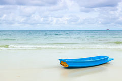 Blue boat on sand beach. Stock Photo