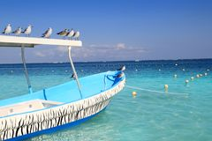 Blue boat seagulls Caribbean turquoise sea Royalty Free Stock Photo