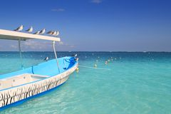 Blue boat seagulls Caribbean turquoise sea Stock Photos