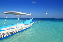 Blue boat seagulls Caribbean turquoise sea Royalty Free Stock Photography