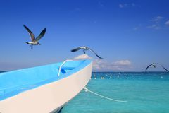 Blue boat seagulls Caribbean turquoise sea Royalty Free Stock Photos