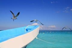 Blue boat seagulls Caribbean turquoise sea Royalty Free Stock Photos