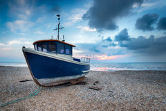 Blue Boat on a Shingle Beach Stock Images