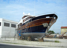 Blue boat in shipyard!. A big boat in shipyard... last paint retouches Royalty Free Stock Images