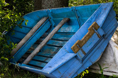 Blue boat Stock Images