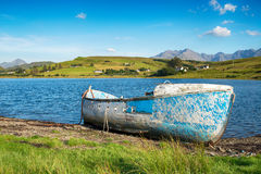 Blue Boat on the Shores of Loch Harport Stock Photos