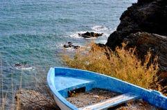 Blue boat stranded Royalty Free Stock Photo