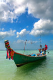 Blue boat, turquoise water Stock Photos