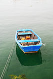 Blue boat in water on Bay of Biscay Royalty Free Stock Photos