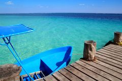 Blue boat in wooden tropical pier in Caribbean Royalty Free Stock Photos