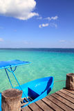 Blue boat in wooden tropical pier in Caribbean Stock Photos