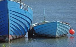 Blue boats stock photos