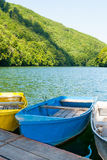Blue boats on the lake. Royalty Free Stock Photo