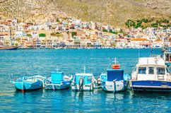 Blue boats moored side-by-side in peaceful port Royalty Free Stock Images