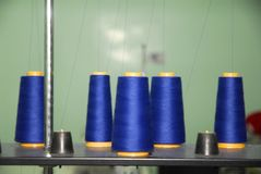 Blue bobbin. On professional sewing-machine Royalty Free Stock Photo