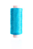 Blue bobbin thread isolated Royalty Free Stock Photography