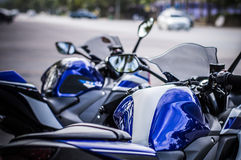 Blue body motorcycle road background Royalty Free Stock Image