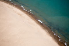 Blue Body of Water Beside Brown Sand during Daytime Royalty Free Stock Images