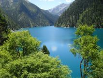 Blue Body of Water and Green Mountains Long Exposure Photography Stock Image