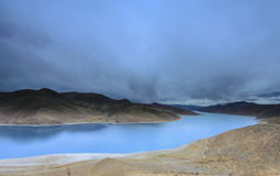 Blue Body of Water Between Mountains Royalty Free Stock Photography