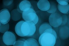 Blue bokeh abstract light black background. S royalty free stock photography