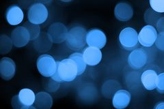 Blue bokeh abstract light black background. S royalty free stock images