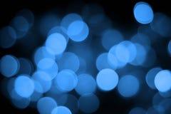 Blue bokeh abstract light black background. S stock photos